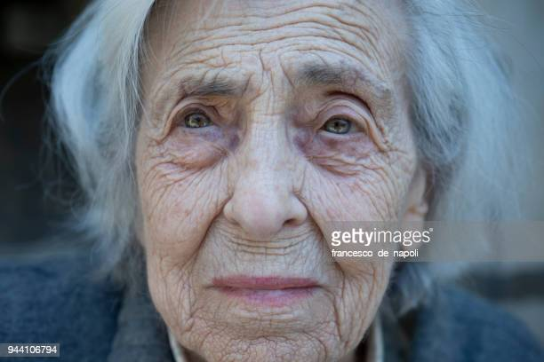 worried senior woman - vulnerability stock pictures, royalty-free photos & images
