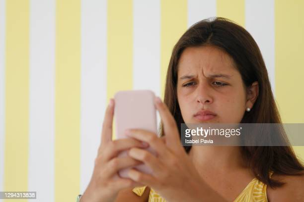 worried teenager girl using smartphone - sadgirl stock pictures, royalty-free photos & images