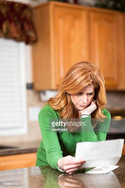 Worried woman going over bills