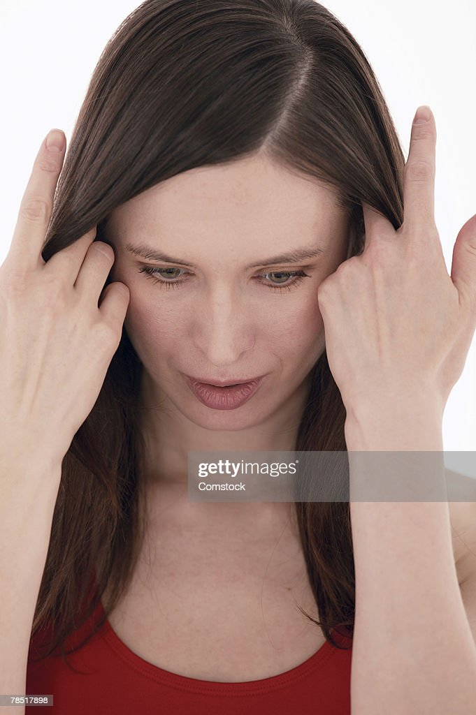 Worried woman looking down : Stock Photo