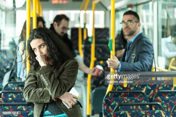 Worried woman riding in a bus
