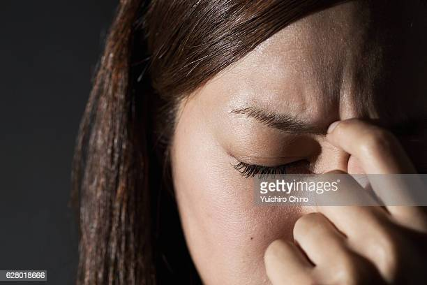 Worried woman rubbing her forehead