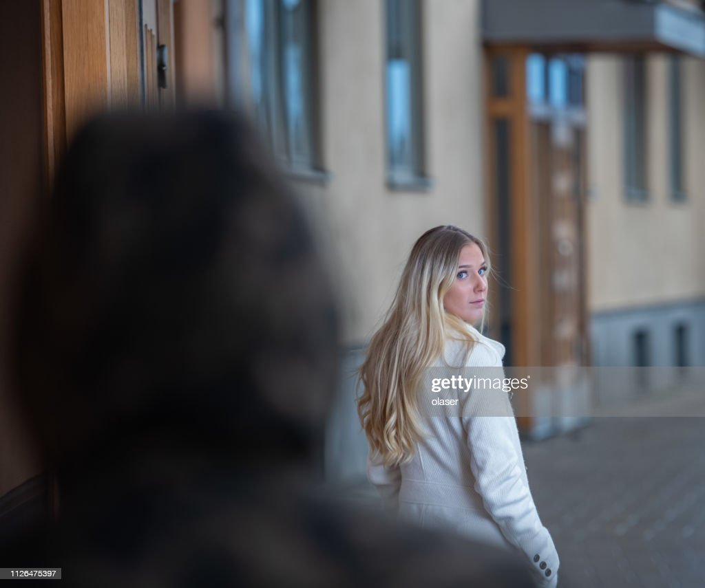 Worried young woman being followed : Stock Photo
