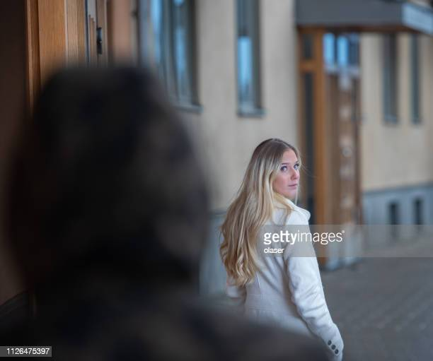 Worried young woman being followed
