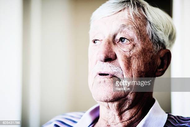 Worried-looking 90-year-old man seems confused