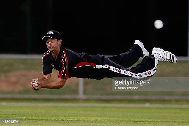 Worrin Williams of ACA takes a spectacular catch during the Imparja Cup match between the Black Caps and ACA at Trager Park on February 9 2014 in...