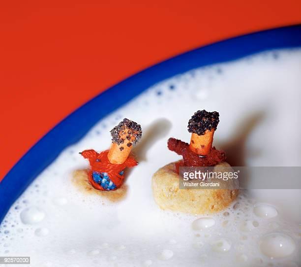 Worry dolls floating in milk