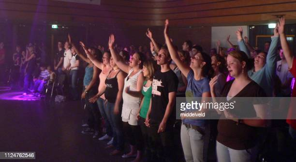 worship and dance performane - pentecostalism stock photos and pictures
