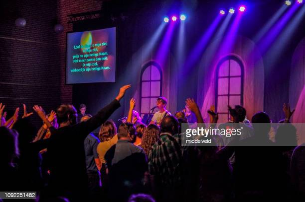 worship and dance - pentecostalism stock photos and pictures
