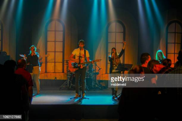 worship performance - religious service stock pictures, royalty-free photos & images