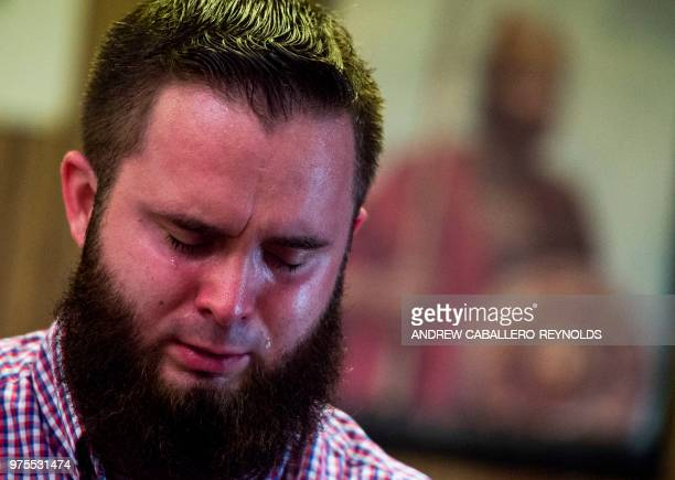 A worshiper cries before a service at the House of the Lord Jesus church in Squire West Virginia on May 27 2018 Pastor Wolford held the extended...