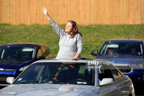 A worshiper listens to a song during the drive in service at On Fire Christian Church on April 05 2020 in Louisville Kentucky Due to the COVID19...