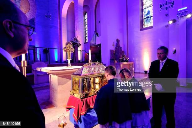A worshiper prays at the chest that contains the Eibingen reliquiae treasure after the annual procession during the Catholic Hildegard Pilgrimage...
