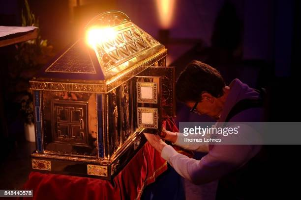 A worshiper prayss at the chest that contains the Eibingen reliquiae treasure after the annual procession during the Catholic Hildegard Pilgrimage...