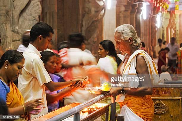 worshipers at meenakshi amman temple in madurai india - tamil nadu stock pictures, royalty-free photos & images