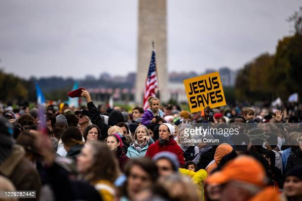 Worshipers attend a concert by evangelical musician Sean Feucht on the National Mall on October 25, 2020 in Washington, DC. Feucht was granted a...