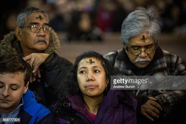 Worshipers attend Mass on Ash Wednesday at St Patrick's Catherdral on February 18 2015 in New York City Ash Wednesday is the holy day that marks the...