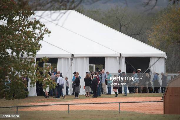 Worshipers attend service at the temporary First Baptist Church of Sutherland Springs on November 12 2017 in Sutherland Springs Texas The service was...