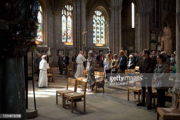 Worshipers attend the main Sunday service of Eucharist on the second day of permitted public worship, the first day of Holy Communion being offered...