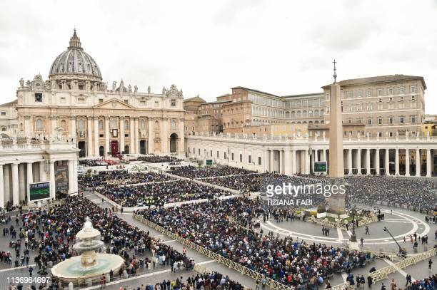Worshipers attend the Pope's Palm Sunday mass on April 14 2019 at St Peter's square in the Vatican