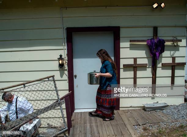Worshipers bring food into the church before a Pentecostal serpent handlers service at the House of the Lord Jesus church in Squire West Virginia on...