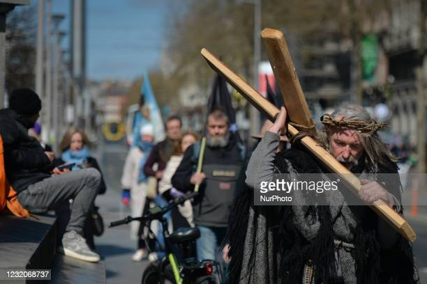 Worshipers during a Solemn Procession on Good Friday 2021, walking and praying from the General Post Office to the 'Papal Cross' in Dublin's Phoenix...
