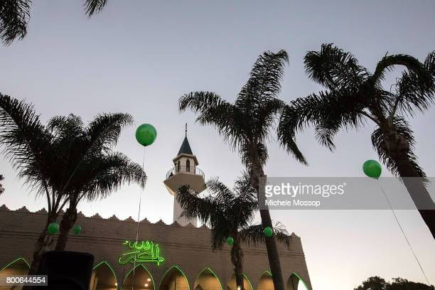 Worshipers flock to the The Imam Ali Bin Abi Taleb Mosque or Lakemba Mosque in suburban Sydney Australia Crowds spill into the street and...