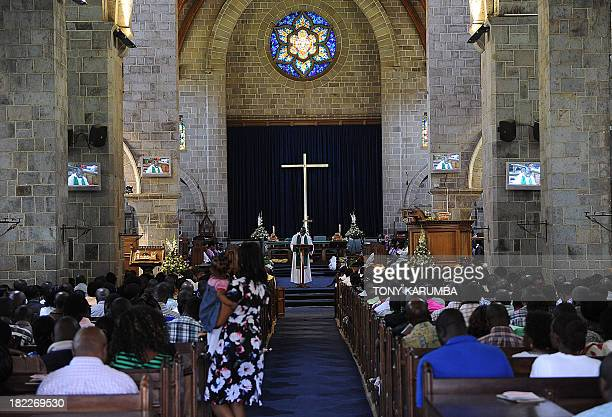 Worshipers gather at the All Saints Cathedral September 29 2013 during a church service where prayers were said for victims and relatives of the...