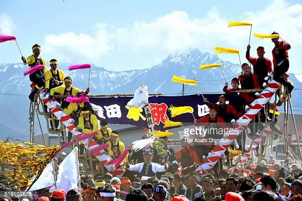 Worshipers of Suwa Taisha shrine haul 'Onbashira' sacred logs during the 'Yamadashi' during the Onbashira Festival on April 2 2016 in Chino Nagano...