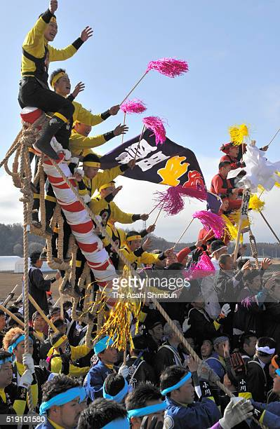 Worshipers of Suwa Taisha shrine haul 'Onbashira' sacred logs during the Yamadashi during the Onbashira Festival on April 2 2016 in Chino Nagano Japan