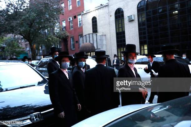 Worshipers of the Congregation Yetev Lev D'Satmar synagogue gather outside New York Citys' neighborhood of Williamsburg in the borough of Brooklyn on...