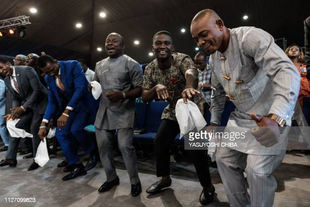 Worshipers of the Nigerian Pentecostal church Salvation Ministries attend the 5th Sunday service at their church headquarters in Port Harcourt...