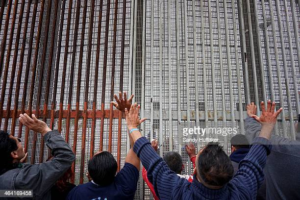 Worshipers participate in a Mass along the USMexico border wall on February 22 2015 in Tijuana Mexico Senior Republican senators said they expected...