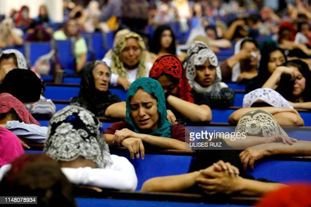 Worshipers pray for their religious leader at the International Headquarters of the Church La Luz Del Mundo in Guadalajara State of Jalisco Mexico on...