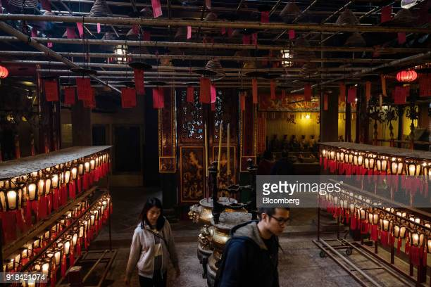 Worshipers walk through the Man Mo Temple in Hong Kong China on Wednesday Feb 14 2018 The city's financial markets will close on Feb 16 for the Lunar...