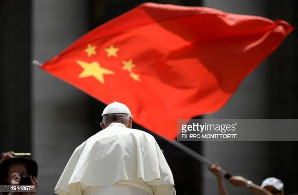 Worshipers waves the flag of China as Pope Francis leaves following the weekly general audience on June 12, 2019 at St. Peter's square in the Vatican.