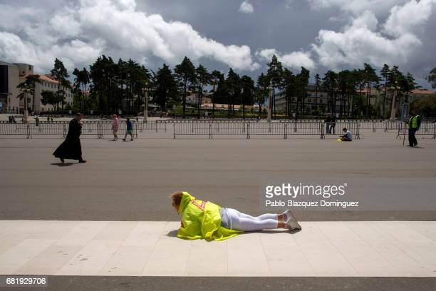 A worshipper crawls in the Sanctuary of Fatima on May 11 2017 in Fatima Portugal Pope Francis will be attending the Sanctuary of Fatima in Portugal...