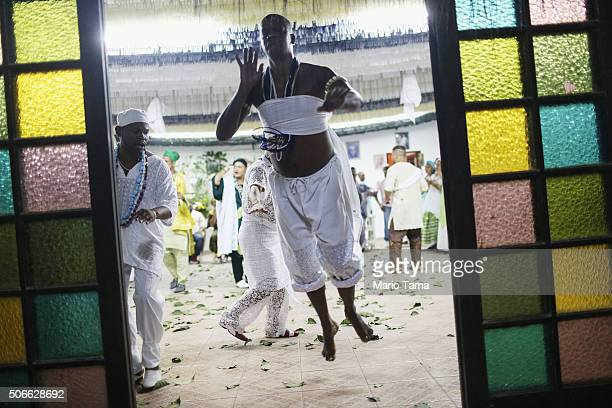 A worshipper dances during a Candomble ceremony on January 24 2016 in Itaborai Brazil Candomble is an AfroBrazilian religion whose practitioners...