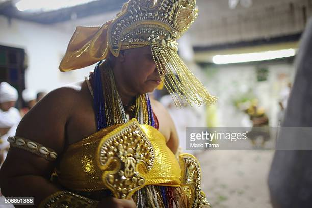 A worshipper is dressed a deity during a Candomble ceremony on January 24 2016 in Itaborai Brazil Candomble is an AfroBrazilian religion whose...