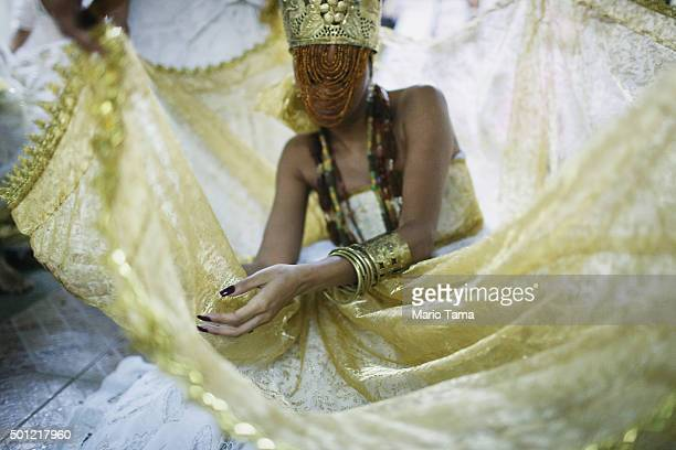 A worshipper is dressed as a female deity during a Candomble ceremony honoring goddesses Iemanja and Oxum on December 13 2015 in Itaborai Brazil...