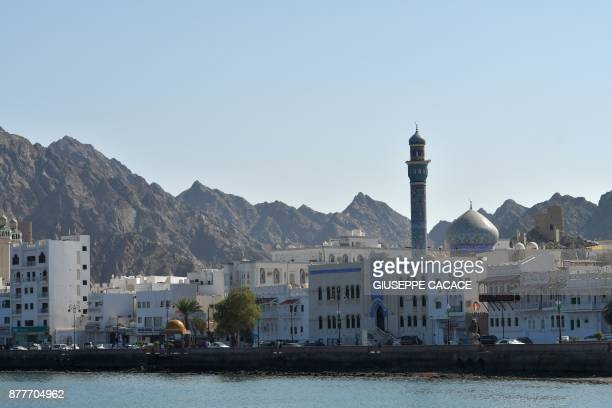 A worshipper prays on October 31 2017 shows a general view of Muscat's AlRasul AlAazam mosque in the Gulf sultanate of Oman Oman home to Sunnis...