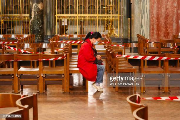A worshipper prays on seats arranged to aid social distancing at Westminster Cathedral in London on June 15 2020 after the church reopened for...