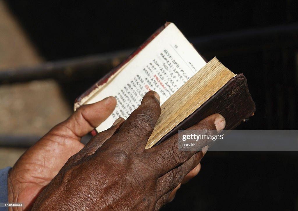 Worshipper Reading Holy Bible in Lalibela Ethiopia : Stock Photo