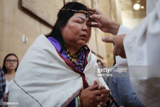 A worshipper receives ashes during Ash Wednesday Mass at the Cathedral of Our Lady of the Angels on February 26 2020 in Los Angeles California Ash...