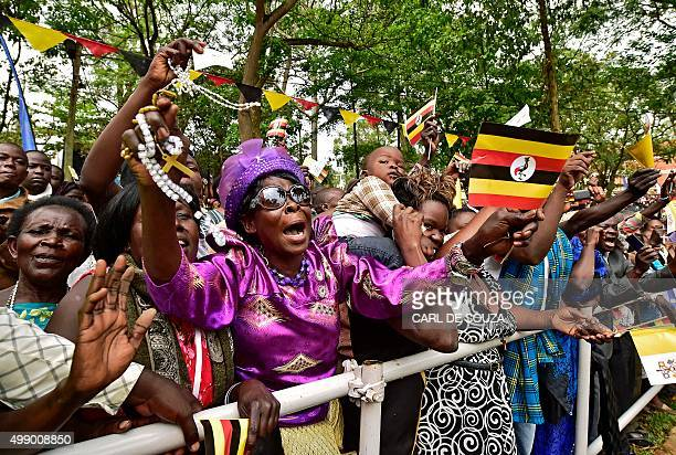 A worshipper sings at Namugongo Martyrs' Shrine during an open air mass held by Pope Francis on November 28 2015 Pope Francis arrived in Uganda on...
