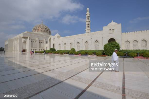 Worshipper walk at Sultan Qaboos Grand Mosque in the Omani capital Muscat on November 27 2018