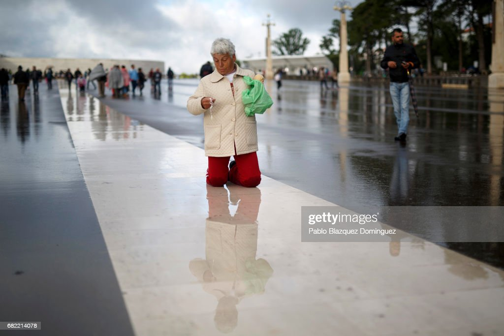 A worshipper walks on her knees as she holds a rosary at the Sanctuary of Fatima on May 12, 2017 in Fatima, Portugal. Pope Francis will be attending the Sanctuary of Fatima, in Portugal, on May 12 and 13 to canonize two Portuguese shepherds, Jacinta and Francisco Marto, who are said to have witnessed the apparition of what they believed was the Virgin Mary, together with their aunt Lucia Santos, during the 100 anniversary. Thousands of pilgrims and worshippers from around the world are expected to gather at the centenary celebration.