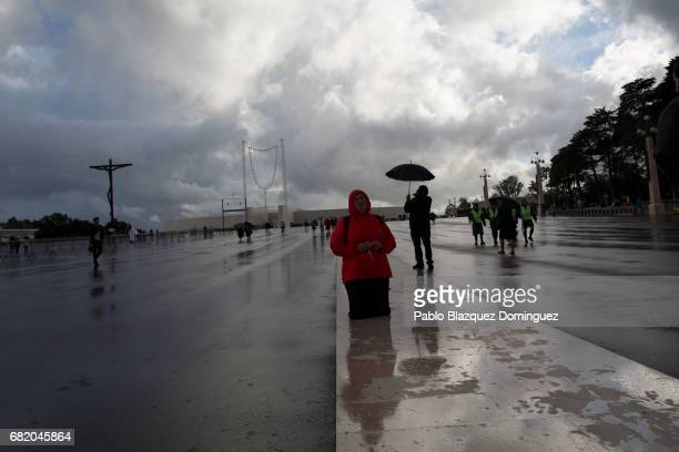 A worshipper walks on her knees in the Sanctuary of Fatima on May 11 2017 in Fatima Portugal Pope Francis will be attending the Sanctuary of Fatima...