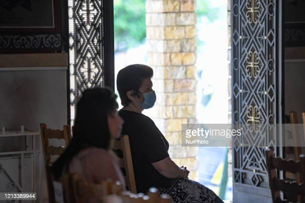 Worshipper wearing a face mask during the reopening of Religious places of worship open to faithful under specific rules in Athens, Greece, on May...
