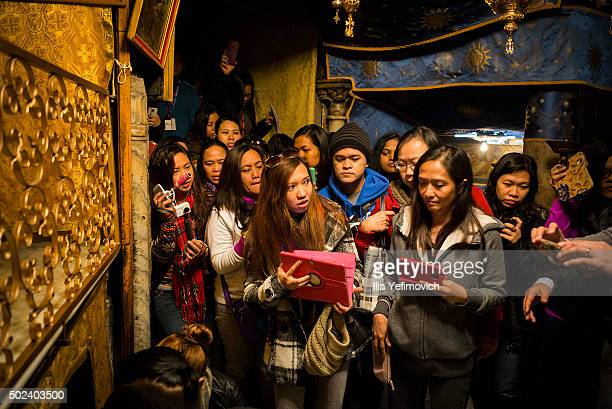 Worshippers and pilgrims gather at the Church of Nativity on December 24, 2015 in Bethlehem, West Bank. Every year thousands of Christian pilgrims...
